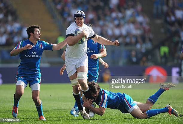 Dave Attwood of England is tackled by Luke McLean and Leonardo Sarto of Italy during the RBS Six Nations match between Italy and England at Stadio...