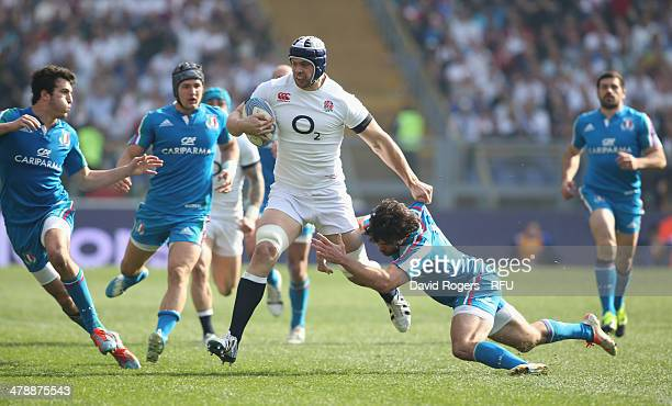 Dave Attwood of England is tackled by Luke McLean and Leonardo Sarto during the RBS Six Nations match between Italy and England at the Stadio...