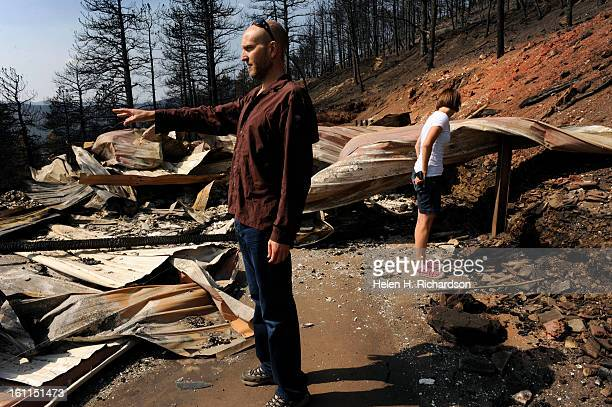 Dave Barnett left and his girlfriend Nikki McManus right sift through the debris of what was once his home Dave Barnett lost everything in the...