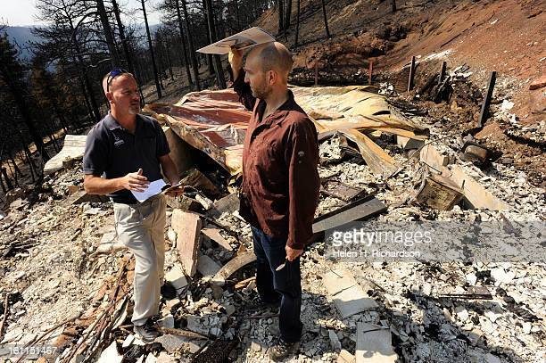 Dave Barnett right talks with Keith Belew left a catastrophe structure adjuster with Allstate Insurance Barnett lost everything in the Fourmile...