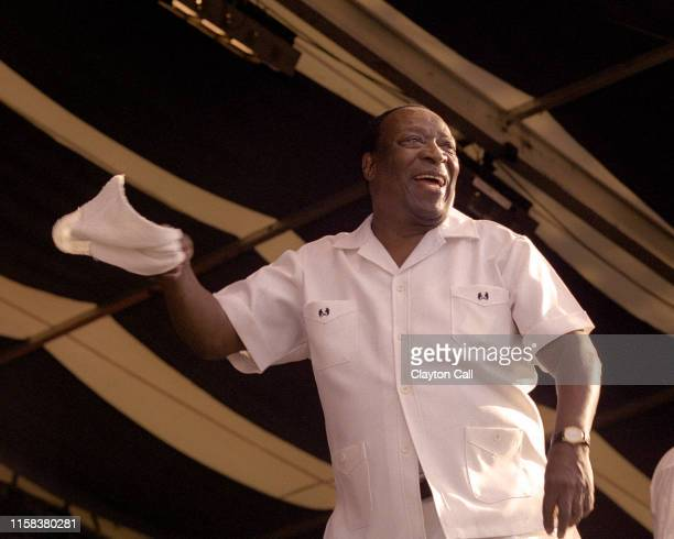 Dave Bartholomew performs with Fats Domino at the New Orleans Jazz & Heritage Festival on April 25, 1999.
