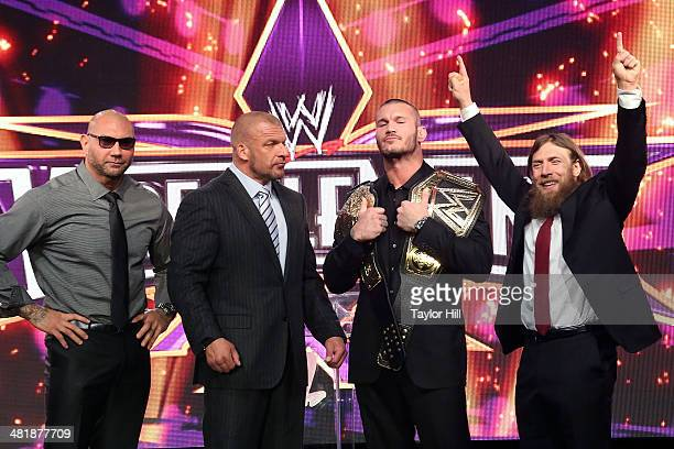 Dave Batista, Triple H, Randy Orton, and Daniel Bryan attend the WrestleMania 30 press conference at the Hard Rock Cafe New York on April 1, 2014 in...