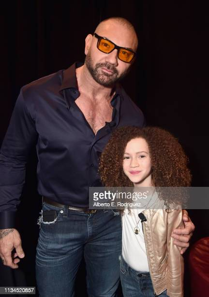Dave Bautista and Chloe Coleman pose backstage at CinemaCon 2019 The State of the Industry and STXfilms Presentation at The Colosseum at Caesars...