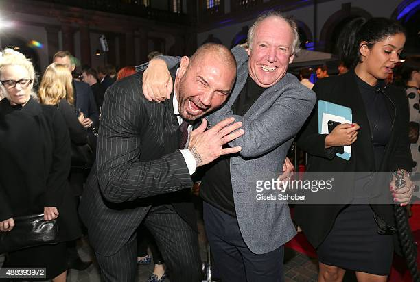 Dave Bautista and Ian Callum during the presentation of the Jaguar Land Rover vehicles starring in the new Bond film 'Spectre' on September 15 2015...