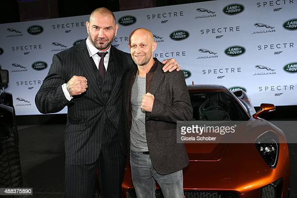 Dave Bautista and Juergen Vogel next to a Jaguar CX75 during the presentation of the Jaguar Land Rover vehicles starring in the new Bond film...