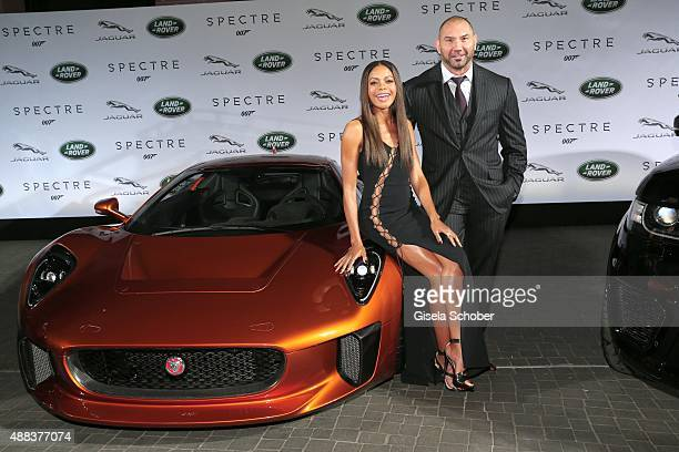 Dave Bautista and Naomie Harris next to a Jaguar CX75 during the presentation of the Jaguar Land Rover vehicles starring in the new Bond film...