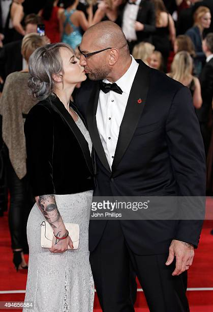 Dave Bautista and Sarah Jade attend the Royal Film Performance of 'Spectre' at Royal Albert Hall on October 26 2015 in London England