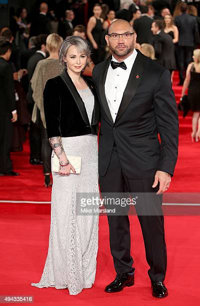 Dave Bautista and wife Sarah Jade attend the Royal Film Performance of 'Spectre' at Royal Albert Hall on October 26 2015 in London England