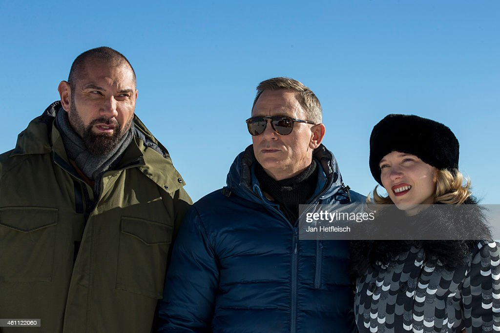 Dave Bautista, Daniel Craig and Lea Seydoux pose at the