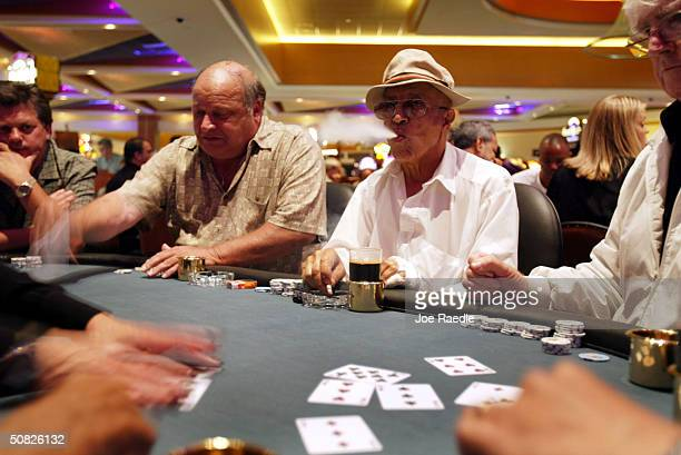 Dave Bee Stephen Madel H Barzilay and Frank Fitzgerald play a game of poker May 11 2004 during the grand opening for the Seminole Hard Rock Hotel and...