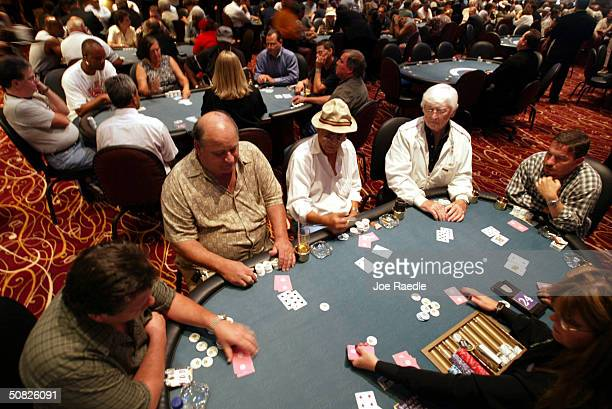 Dave Bee Stephen Madel H Barzilay Frank Fitzgerald and Aaron Allison play a game of poker May 11 2004 during the grand opening for the Seminole Hard...