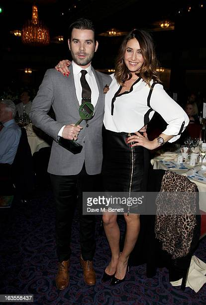 Dave Berry and Lisa Snowdon winners of the Radio/Digital Radio Programme award attend the TRIC Television and Radio Industries Club Awards at The...