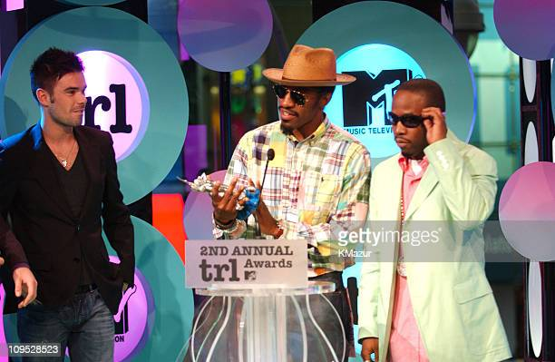 Dave Berry of 'TRL UK' with Andre 300 and Big Boi of OutKast winner of the Roc the Mic Award