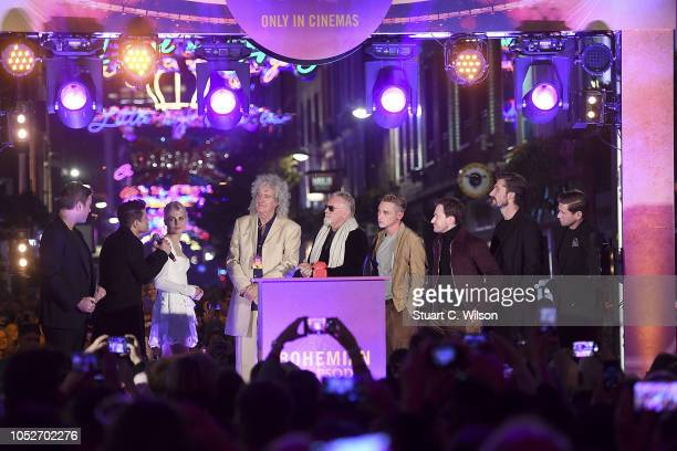 Dave Berry Rami Malek Lucy Boynton Roger Taylor Brian May Ben Hardy Joe Mazzello and Gwilym Lee turn on the Carnaby Street Bohemian Rhapsody Light...