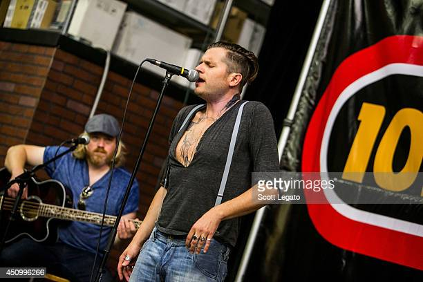 Dave Beste and Jay Buchanan of Rival Sons performs in concert at Motor City Guitars on June 21 2014 in Waterford Michigan