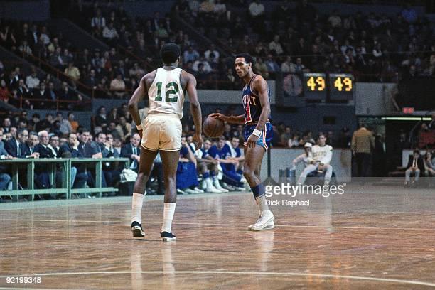 Dave Bing of the Detroit Pistons moves the ball against Don Chaney of the Boston Celtics during a game played in 1968 at the Boston Garden in Boston...