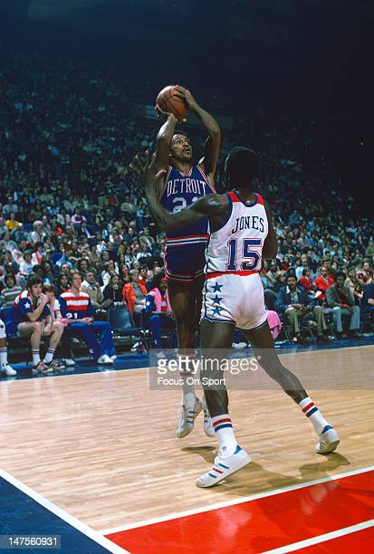 Dave Bing of the Detroit Pistons shoots over Jimmy Jones of the Washington Bullets during an NBA basketball game circa 1974 at the Capital Centre in...