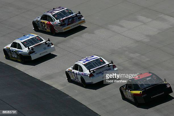 Dave Blaney driver of the PRISM Motorsports Toyota races Scott Speed driver of the Red Bull Toyota John Andretti driver of the Taco Bell Chevrolet...