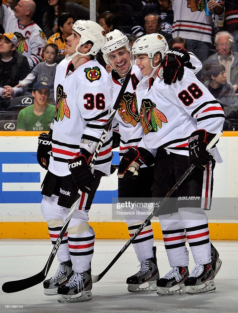 Dave Bolland #36 and Patrick Sharp #10 celebrate after a goal by teammate Patrick Kane #88 against the Nashville Predators at the Bridgestone Arena on February 10, 2013 in Nashville, Tennessee.