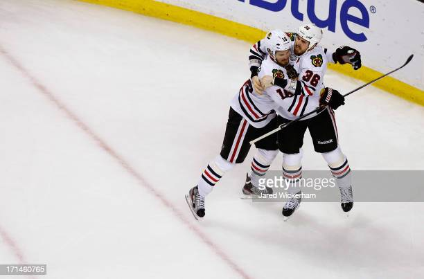 Dave Bolland celebrates with teammate Marcus Kruger of the Chicago Blackhawks after scoring the gamewinning goal in the third period against the...