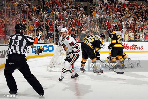 Dave Bolland of the Chicago Blackhawks celebrates after scoring the game winning goal against Boston Bruins in the third period of Game Six of the...