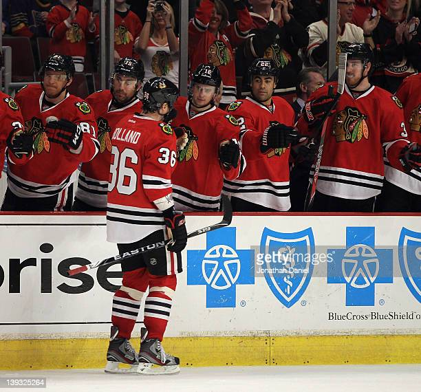 Dave Bolland of the Chicago Blackhawks is congratulated by teammates after scoring a goal in the third period against the St Louis Blues at the...