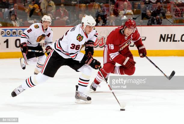Dave Bolland of the Chicago Blackhawks skates up ice with the puck while being chased by Shane Doan of the Phoenix Coyotes on January 6 2009 at...