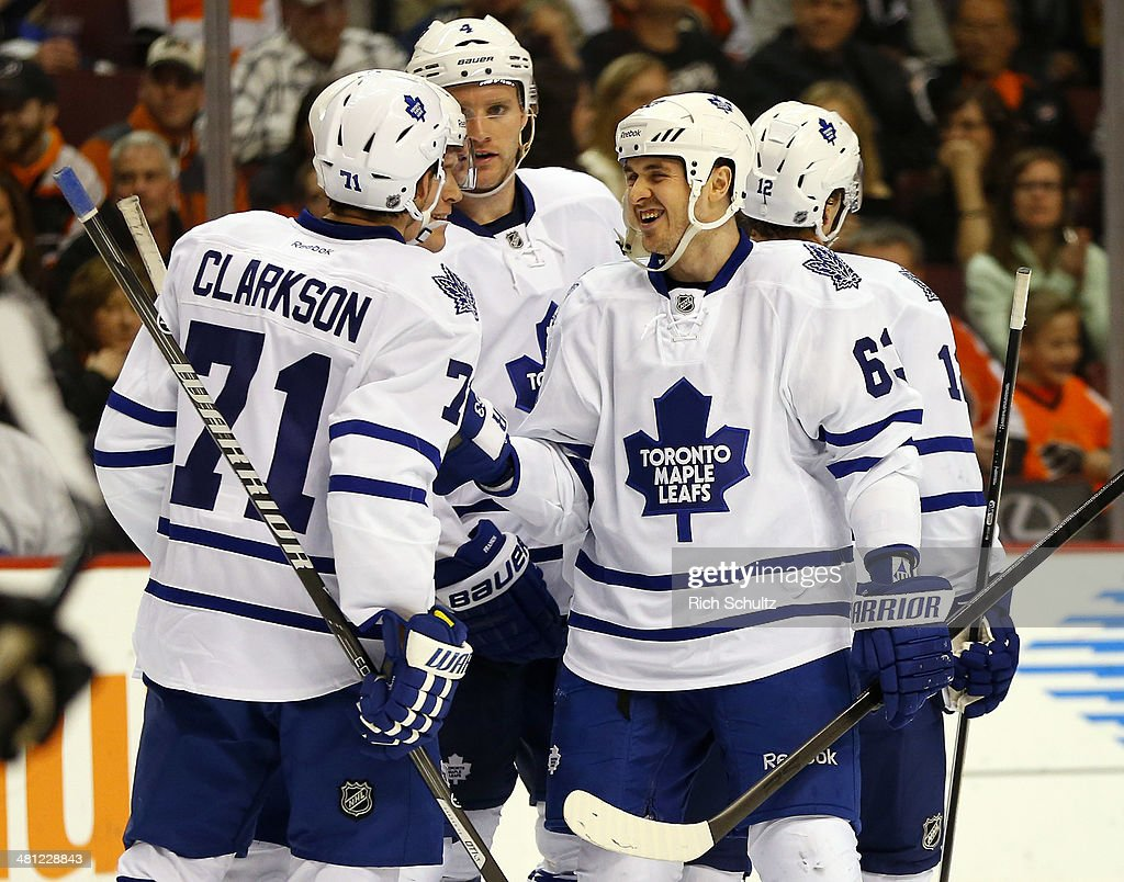 Dave Bolland #63 of the Toronto Maple Leafs is congratulated by teammates David Clarkson #71 and Cody Franson #4 after scoring a goal in the third period against the Philadelphia Flyers at Wells Fargo Center on March 28, 2014 in Philadelphia, Pennsylvania. The Flyers defeated the Maple Leafs 4-2.