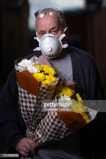 Dave Bott poses wearing his face mask as he goes about essential chores on May 13 2020 in Darlaston West Midlands United Kingdom People are beginning...