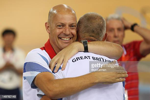 Dave Brailsford, British Cycling Perfromance Director hugs coach Shane Sutton after Victoria Pendleton of Great Britain's gold medal-winning display...