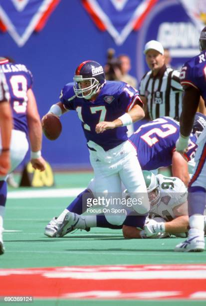 Dave Brown of the New York Giants gets tackled by Andy Harmon of the Philadelphia Eagles during an NFL football game September 4 1994 at Giants...
