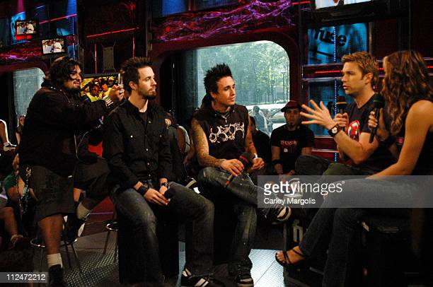 Dave Buckner Jerry Horton and Jacoby Shaddix of Papa Roach with Fuse VJs Steven and Marianela