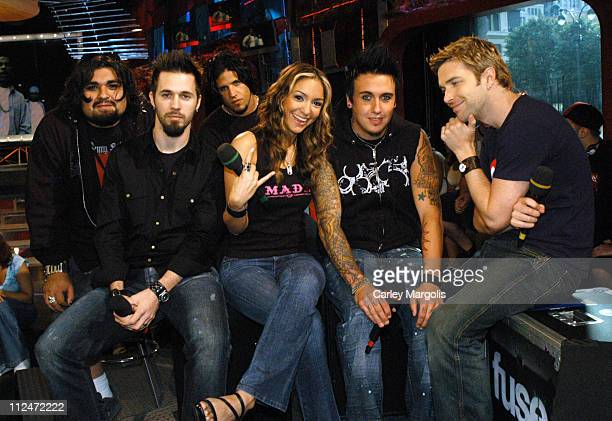 Dave Buckner Jerry Horton Tobin Esperance and Jacoby Shaddix of Papa Roach with Fuse VJs Marianela and Steven