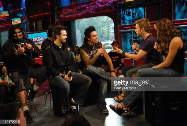Dave Buckner Tobin Esperance Jerry Horton and Jacoby Shaddix of Papa Roach with Fuse VJs Steven and Marianela