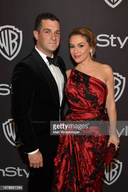 Dave Bugliari and Alyssa Milano attend the 2019 InStyle and Warner Bros 76th Annual Golden Globe Awards PostParty at The Beverly Hilton Hotel on...