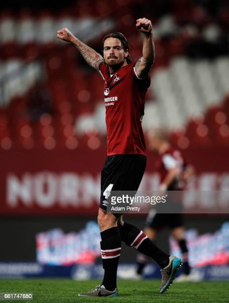 Dave Bulthuis of 1FC Nuernberg celebrates victory in the Second Bundesliga match between 1 FC Nuernberg and Karlsruher SC at Arena Nuernberg on March...