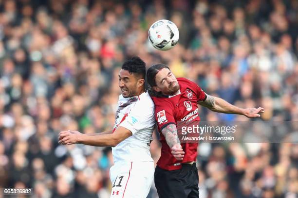 Dave Bulthuis of Nuernberg battles for the ball with Aziz Bouhaddouz of St. Pauli during the Second Bundesliga match between 1. FC Nuernberg and FC...