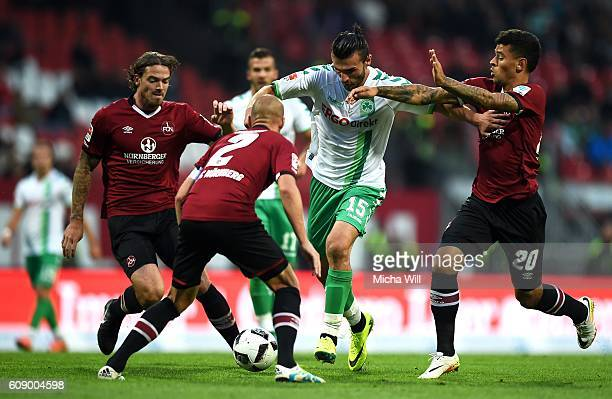 Dave Bulthuis of Nuernberg Shawn Parker Serdar Dursun of Fuerth and #n20# tussle for the ball during the Second Bundesliga match between 1 FC...