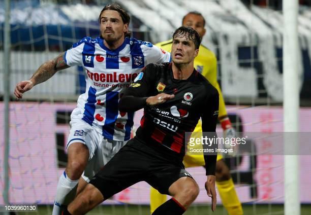 Dave Bulthuis of SC Heerenveen Jurgen Mattheij of Excelsior during the Dutch Eredivisie match between Excelsior v SC Heerenveen at the Van Donge De...
