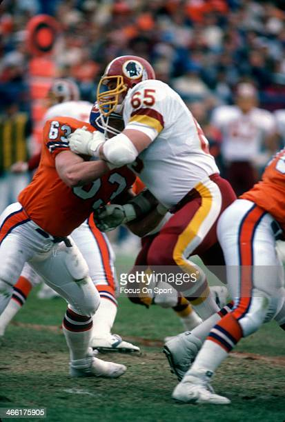 Dave Butz of the Washington Redskins gets blocked by Mark Cooper of the Denver Broncos during an NFL football game December 13 1986 at Mile High...