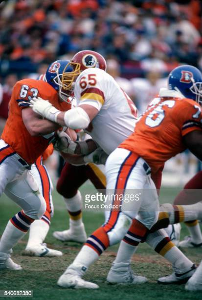 Dave Butz of the Washington Redskins in action against Mark Cooper of the Denver Broncos during an NFL football game December 13 1986 at Mile High...