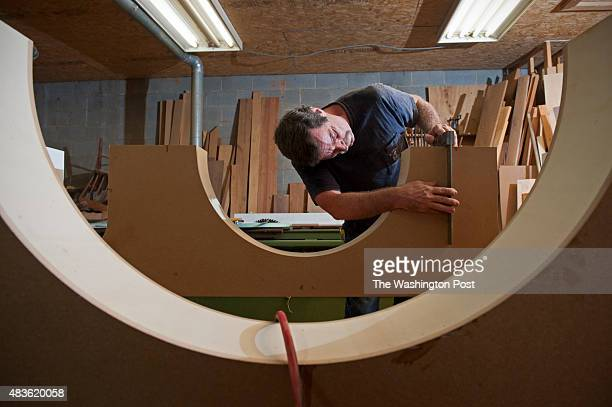 Dave Cahoon begins work on the altar that will be used by Pope Francis during his visit to Washington August 06 2015 in Poolesville MD He's using...