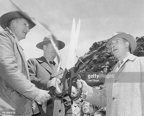 MAY 29 1954 MAY 30 1954 Dave Canfield superintendent of Rocky Mountain National park smiles broadly as Rod McConnell of Estes Park and Ray Rusk of...