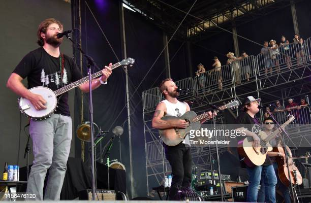 Dave Carroll Dave Simonett and Tim Saxhaug of Trampled by Turtles perform during the 2019 Bonnaroo Music Arts Festival on June 16 2019 in Manchester...