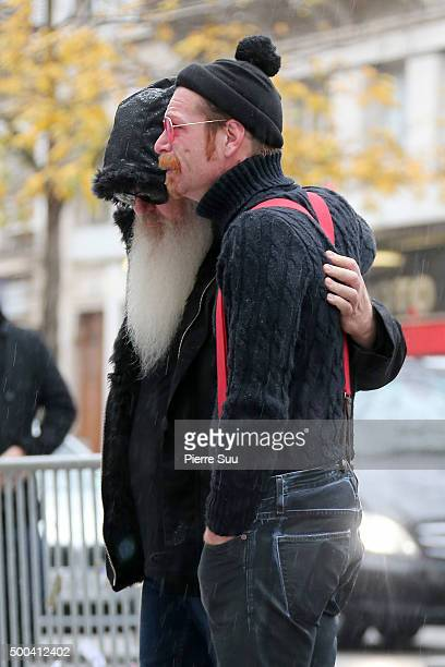 Dave Catching and Jesse Hughes of Eagles of Death Metal show their emotions as they looks at the flower memorial in front of The Bataclan concert...