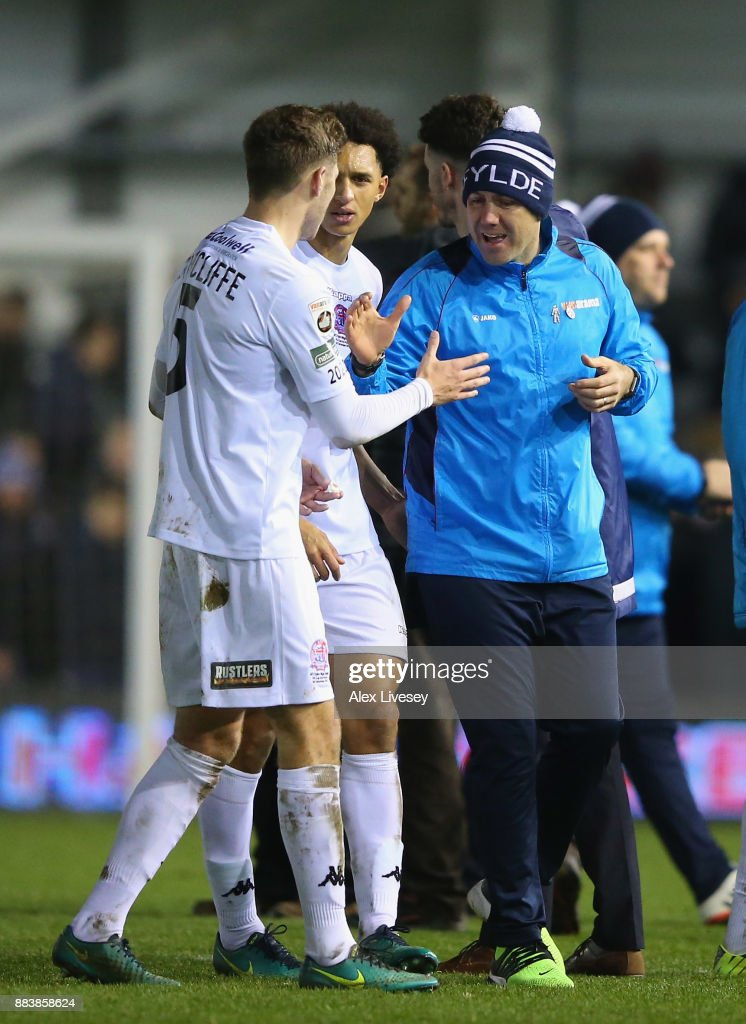 Dave Challinor the manager of AFC Fylde celebrates with Jordan Tunnicliffe after The Emirates FA Cup Second Round between AFC Fylde and Wigan Athletic on December 1, 2017 in Kirkham, England.