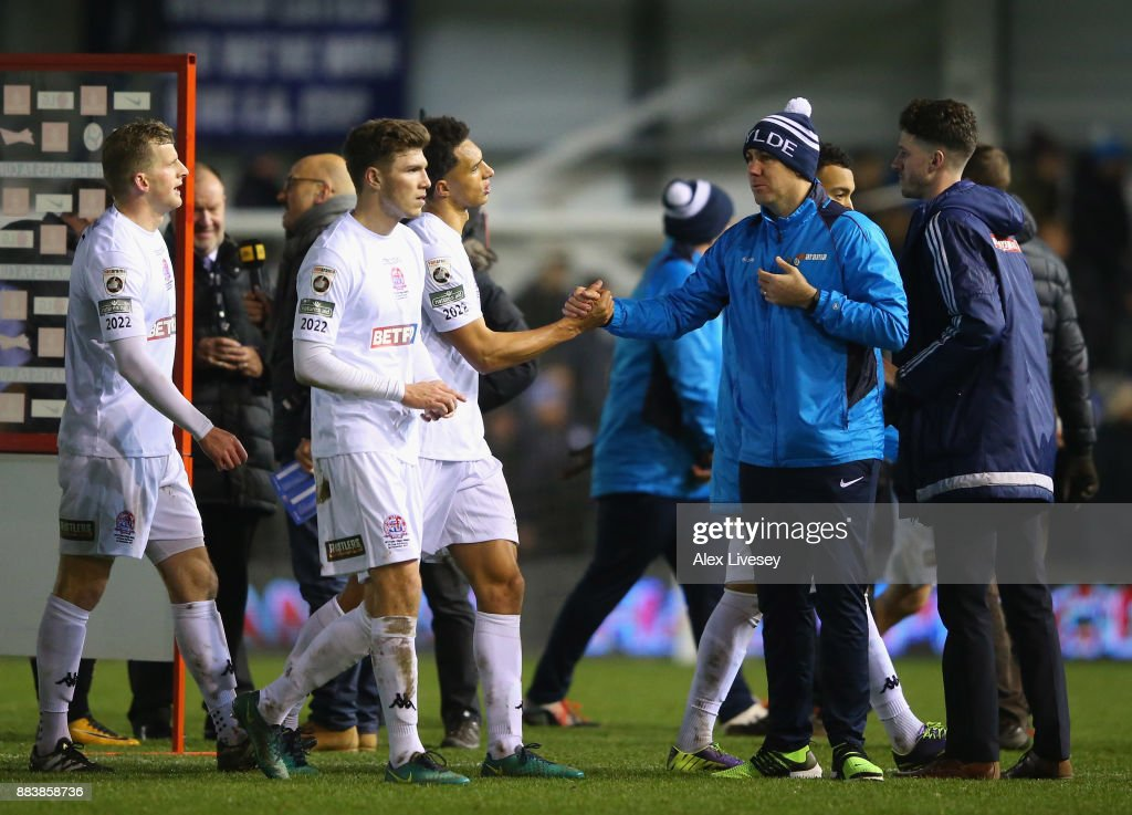 Dave Challinor the manager of AFC Fylde congratulates his players after The Emirates FA Cup Second Round between AFC Fylde and Wigan Athletic on December 1, 2017 in Kirkham, England.