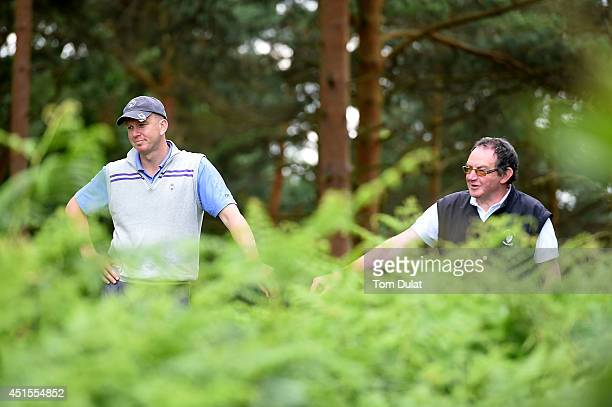 Dave Chalmers and Matthew Kirby of Bognor Regis Golf Club look on during the Lombard Trophy South Regional Qualifier at Camberley Heath Golf Club on...