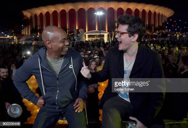 Dave Chappelle and and John Mayer attend Dave Chappelle and John Mayer Controlled Danger at The Forum on December 31 2017 in Inglewood California