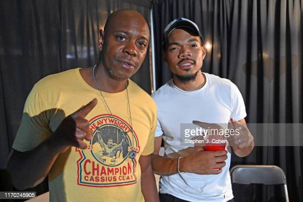 Dave Chappelle and Chance The Rapper pose backstage during Dave Chappelle's Block Party on August 25, 2019 in Dayton, Ohio.